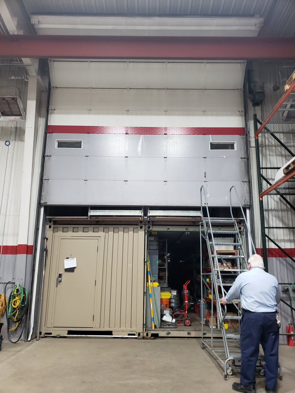 A 16' overhead door opens to reveal 4 containers