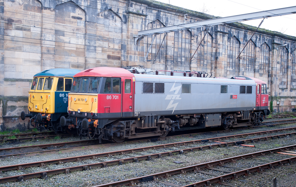 "Assigned to ""Carlisle Standby Ice Breaker"" service, Class 86 electrics 86701 Orion and 86101 Sir William A. Stanier FRS  await the call to duty at Citadel Station, Carlisle."