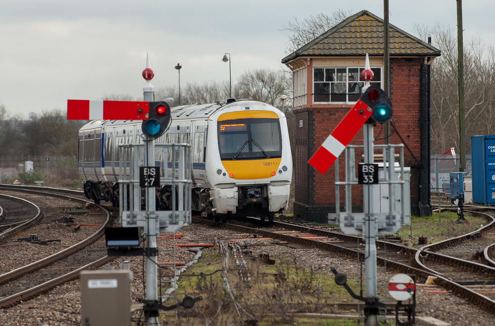 The signaller in Banbury South Signal Box is busy as Chiltern Class 168/1 Clubman DMU departs with an upbound Banbury-London Marylebone service. Semaphore signals in the foreground were installed within past year to facilitate diversions from Reading station work.