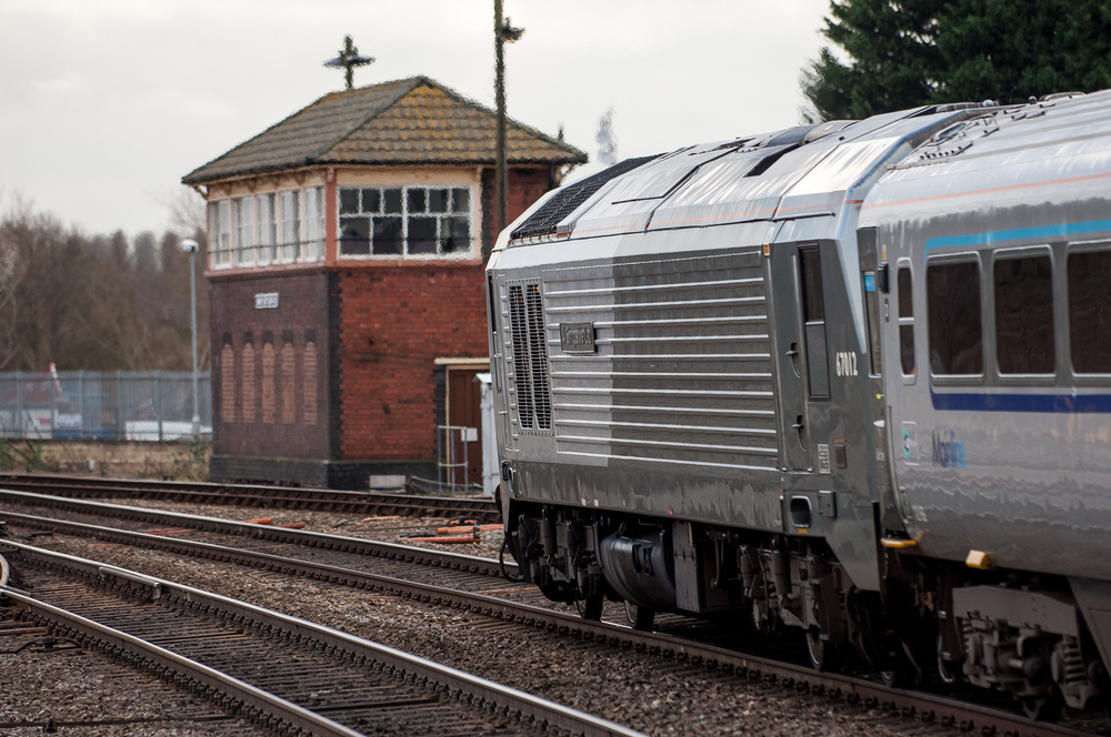 Chiltern 67012, A Shropshire Lad, shoves into Banbury on the rear of a train from London Marylebone.