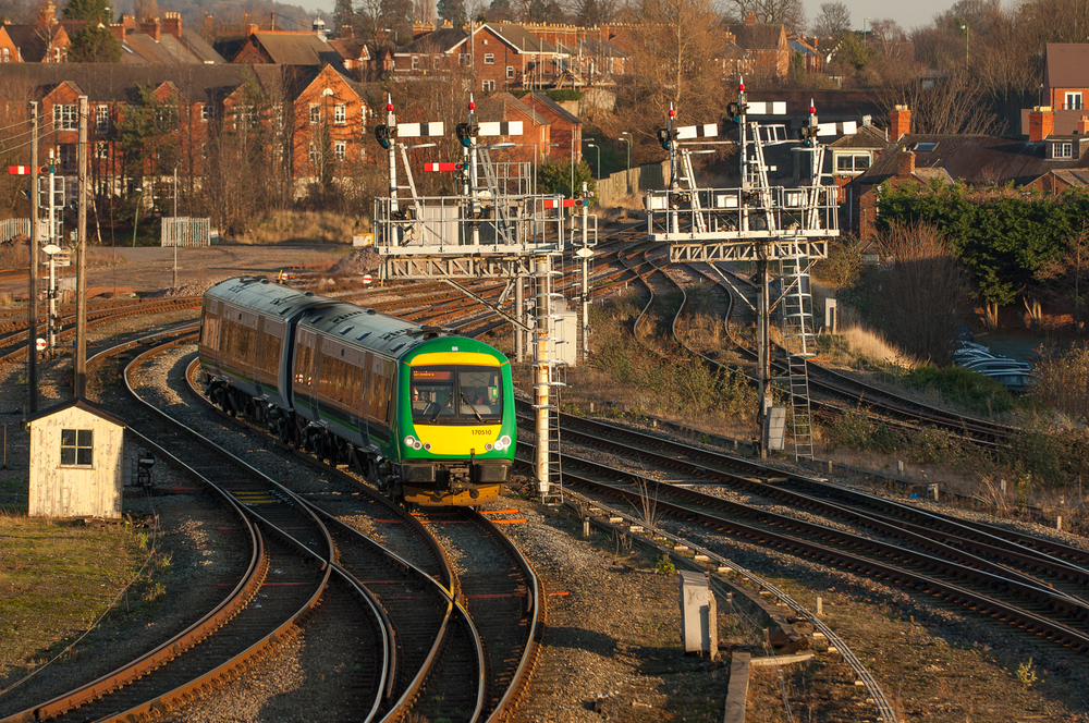 Negotiating its way through a forest of semaphores, London Midland Turbostar DMU 170510 arrives with 1J18 from Birmingham New Street. Fringe box Abbey Foregate Junction is visible to the right of the semaphores.