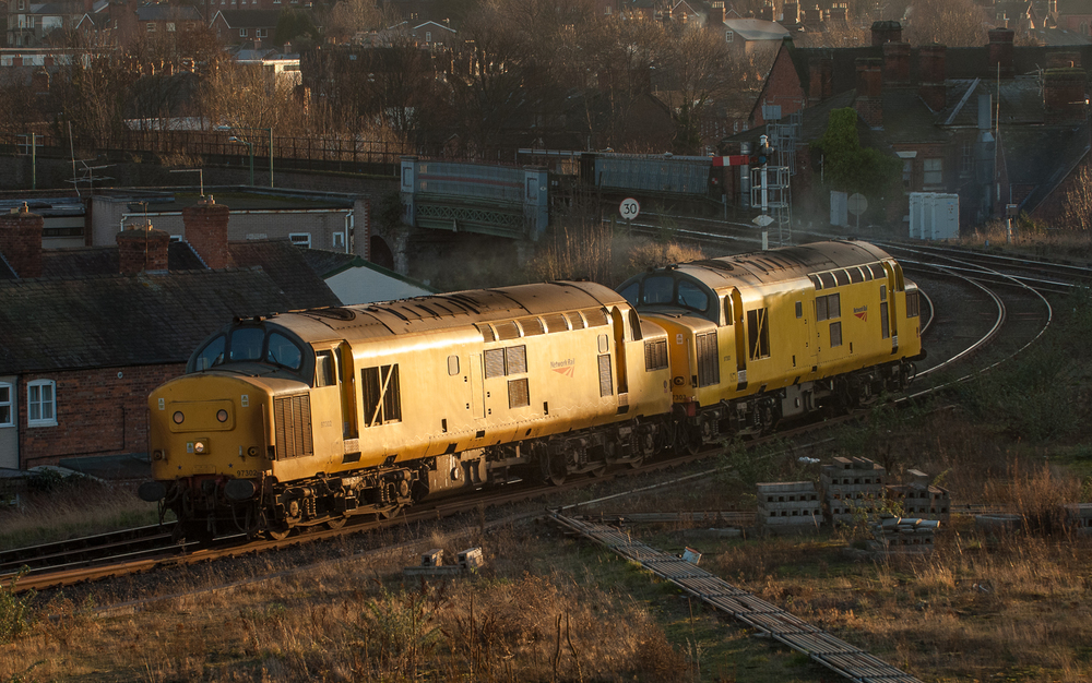 Late afternoon sun catches the flanks of Network Rail 97302 and 97303 working their way from Coleham to Derby RTC for fuel and exam.