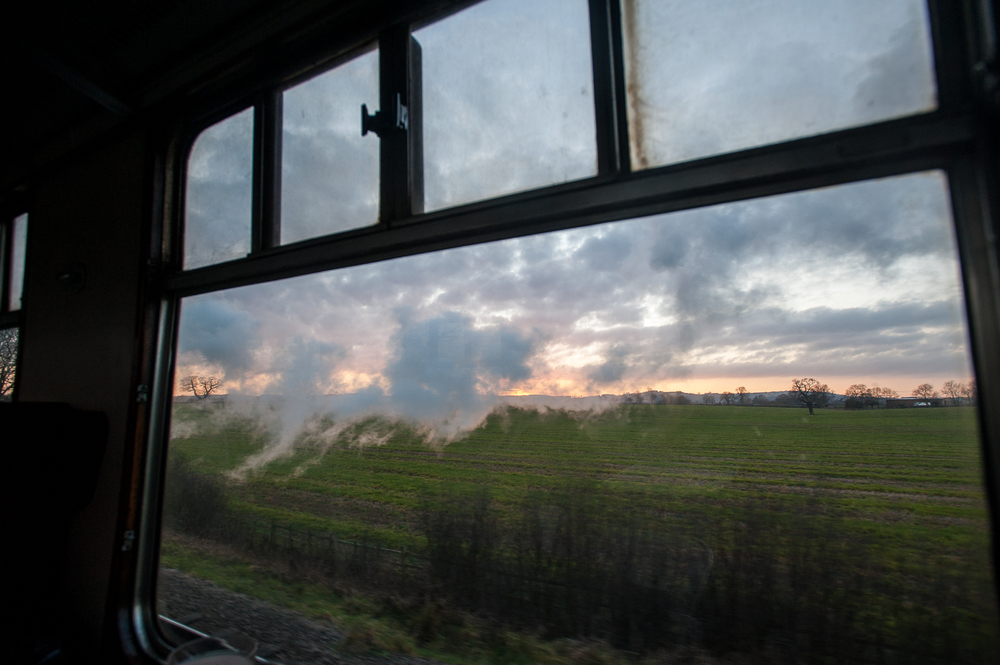 Watching wisps of steam drift past a Leicestershire sunset framed in the coach window, listening to the rapid exhaust and sharp whistle of the King Arthur class 4-6-0 up front, and reflecting the incredible good fortune of such a day.