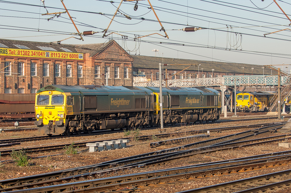 Freightliner Class 66s Nos. 66596 and 66560 drift past The Plant.