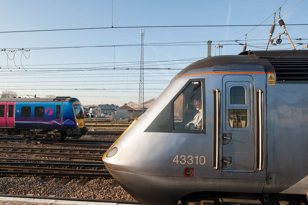Making a passenger stop on its way to King's Cross, Class 43 No. 43310 encounters Desiro No. 185149 arriving with a TransPennine service to Cleethorpes.