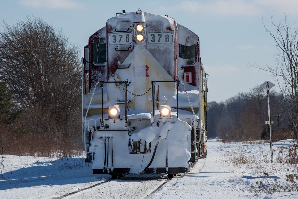 Reversing at Ostrander for a second run at the drifts that claimed the Tillsonburg freight.