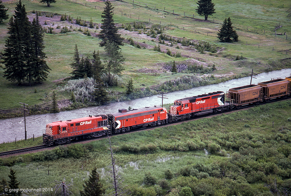 Tracing the Crowsnest River, No. 72 rolls east of Coleman, headed for a meet with Extra 8632 West at Blairmore.