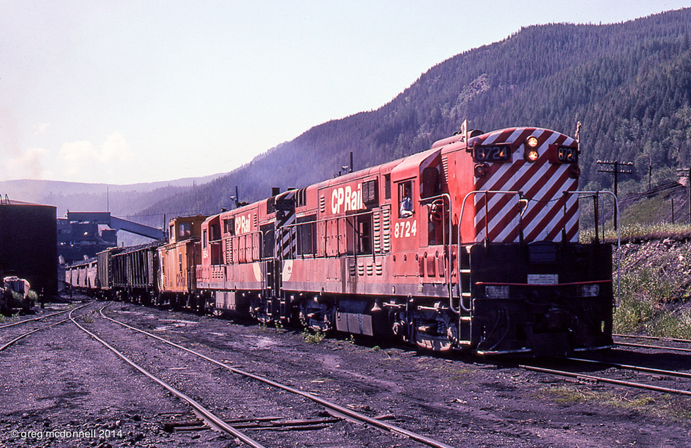 Gritty old-school railroading: the Michel switcher shunts triple-hoppers and vintage high-side 348-series gons at the coal tipple at Michel, B.C.