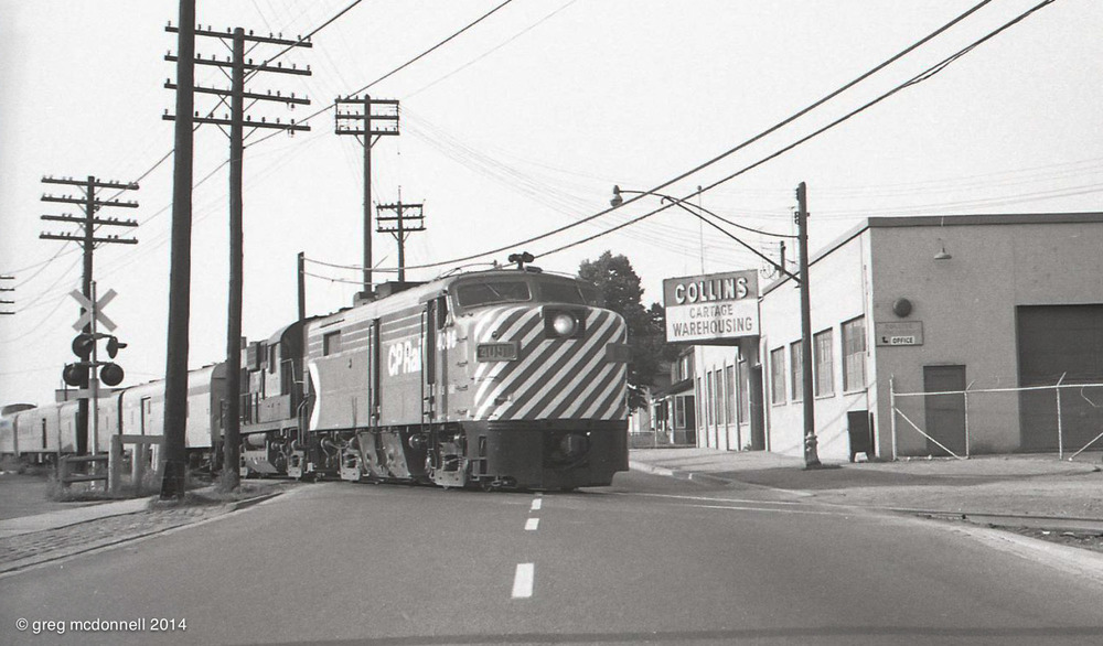 FPA2 4096, the first MLW cab in CP Rail paint, and RS10 8565 bring No. 12 across Old Weston Road.