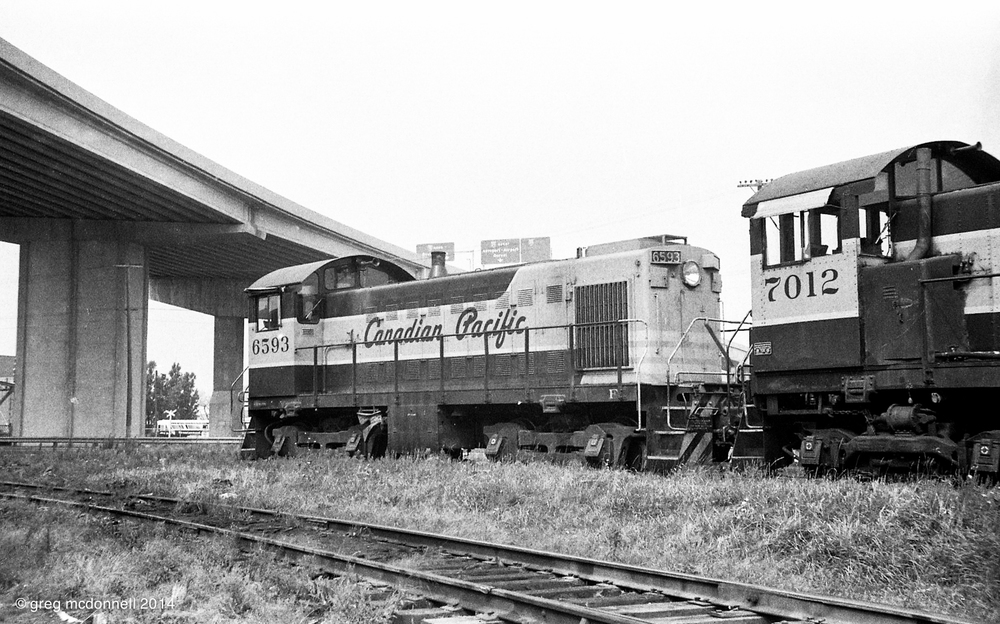 CP 6593 at Cote St. Paul Yard in Montreal, Quebec, September 1, 1969. Just one of the ever-present maroon-and-grey S-series switchers that abounded in the Montreal Terminals.