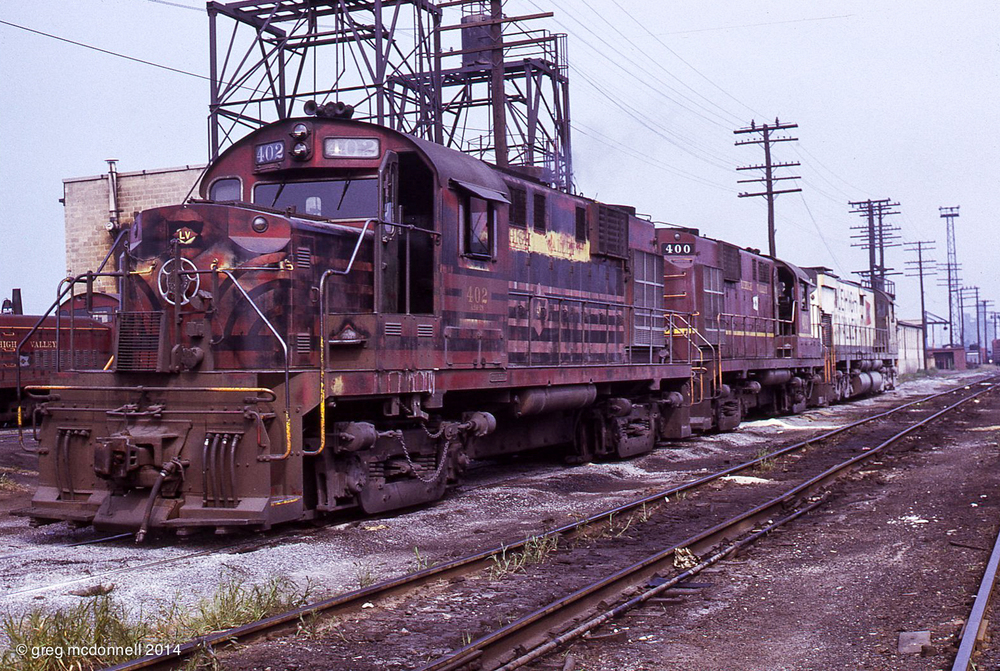 Lehigh Valley's Tifft Street yard and enginehouse was a mandatory stop. And never a disappointment. LV RS11s 402 and 400 and C628 641 idle on shop track.