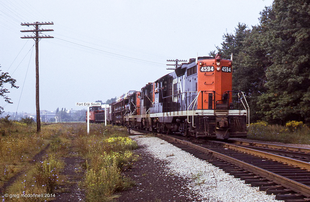A stop at CN Fort Erie before crossing the Peace Bridge was a ritual of almost every Buffalo trip. Our first photo of the day was Extra 4594 East arriving on the Dunnville Sub with only an open tri-level, a boxcar and gon separating the engines and van.