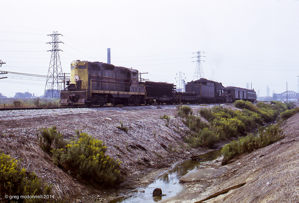 The Buffalo wrecker, complete with ex-Erie steam crane 03133 heads east behind GP7 No. 1209.