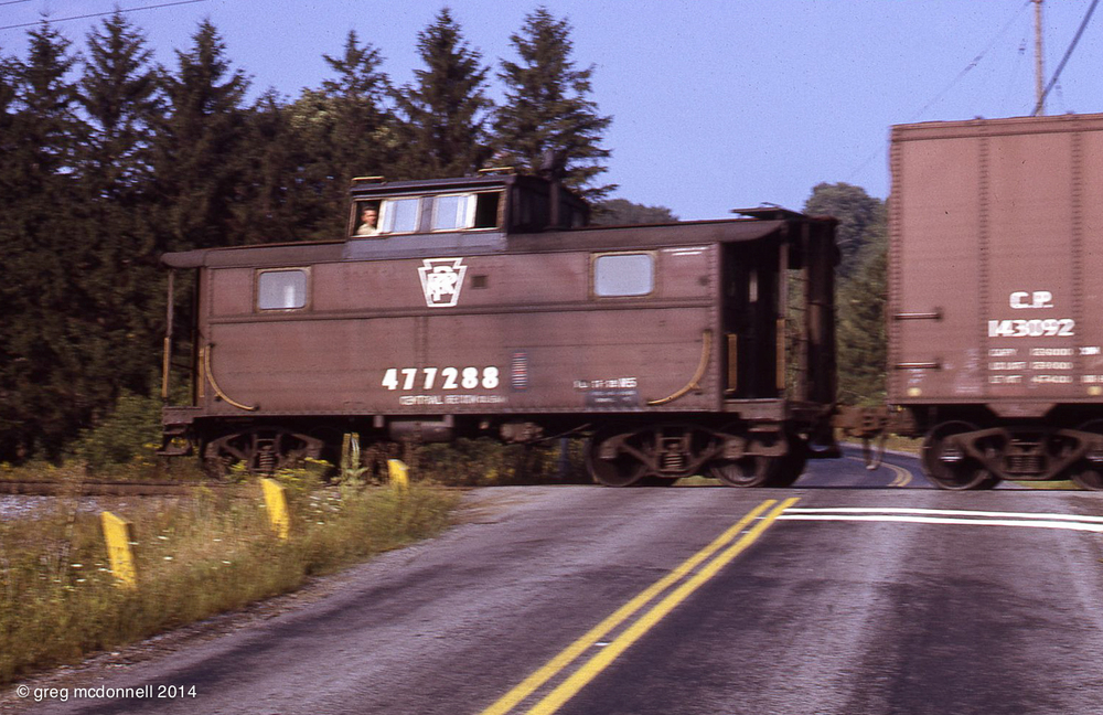 Perfect punctuation: Pennsy cabin car, N5 47728, brings up the markers.