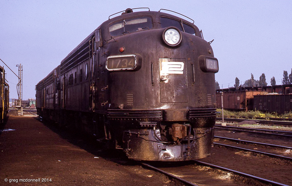 Penn Central Fs were Buffalo regulars; an A-A-A set led by patch-painted 1734 idles at the shop.