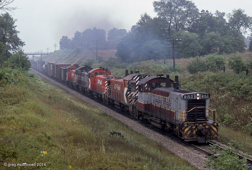 Five — count 'em, five — SW1200s depart Galt, Ont. with the eastbound Aberdeen Turn On August 3, 1975.