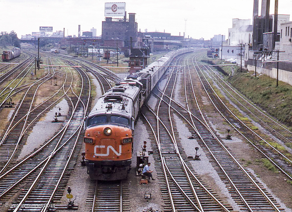 A run-of-the-mill view at the time, this image of CN No. 4 passing Cabin D in downtown Toronto is captivating some 44 years later. In no small measure for the switchtender sitting outside his shack in the foreground. Little did Paul and I know that a few hours later, we'd be speeding through the night, Montreal-bound in the cab of CN 6534.