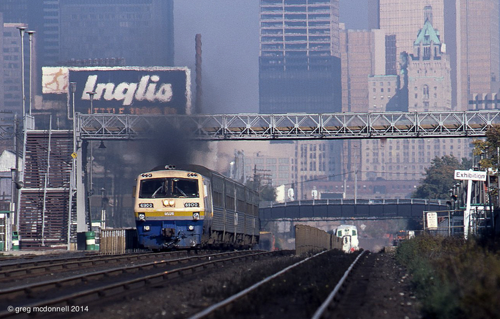 The Royal York dominates the downtown skyline as VIA LRC No. 6900 accelerates westward with Windsor-bound train 75 in October 1984.