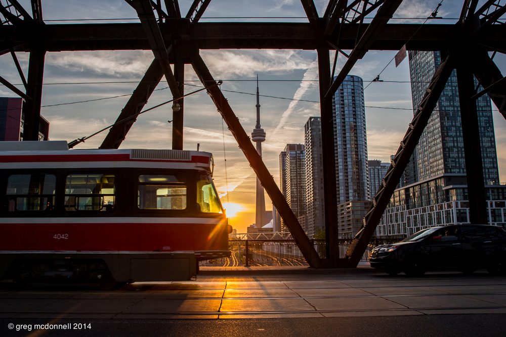 Watching the sunrise as streetcars dart back and forth over the bridge and GO, VIA, and Amtrak trains roared underneath. Time well spent.