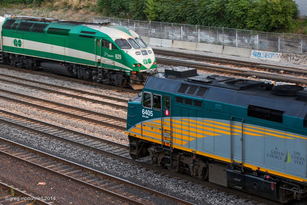 VIA No. 71's train backs toward Union as a westbound GO train departs for the Oakville Sub.