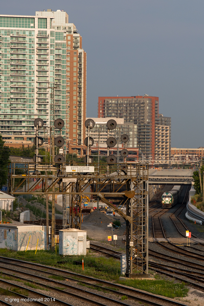 Construction of the fly-under and new trackage continues as GO 633 arrives with a train from Milton.