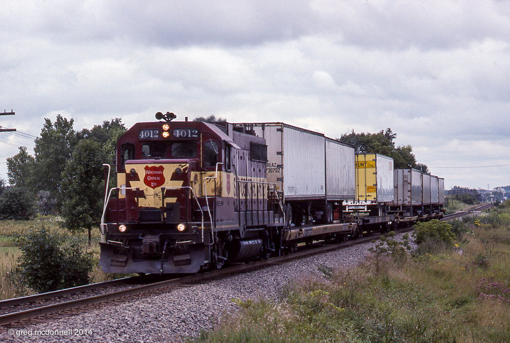 WC 4012 sprints toward the lunch crowd at Duplainville with hotshot No. 220.