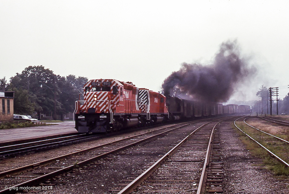 No. 904 accelerates past the station at Galt with factory-fresh CP 5612 and 5624 making their first eastbound trip in the smoky company of M636 4710 on July 14, 1972.