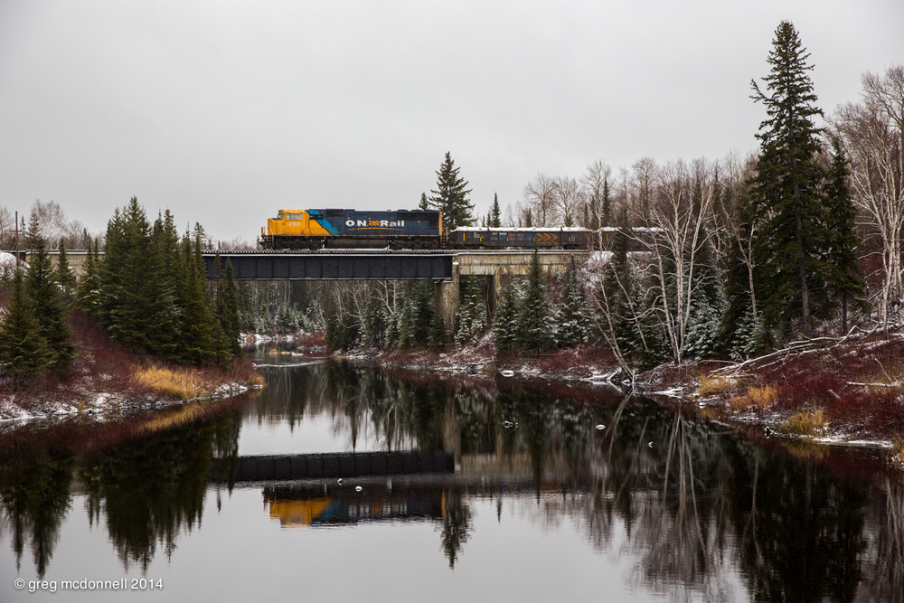 Homebound for Englehart and re-symboled as No. 308, the Timmins turn crosses the Porcupine River just east of Kidd.
