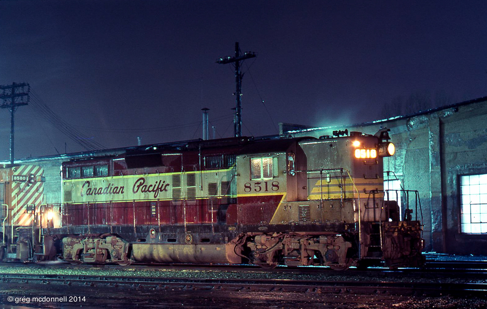 Glistening in the rain, CP 8518 and RS10 8580 await a late-night call at the Quebec Street roundhouse in London, Ontario.