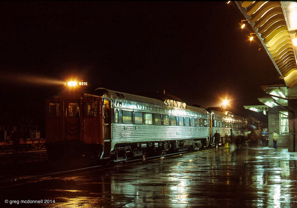 CN RDC1 6116 leads No. 664 as the London-Toronto train makes its station stop at Stratford, Ontario, on a rainy night.