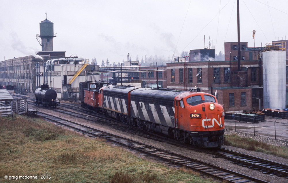 CN F7As 9179 and 9178 switching at Elmira, Ont., November 23, 1977.