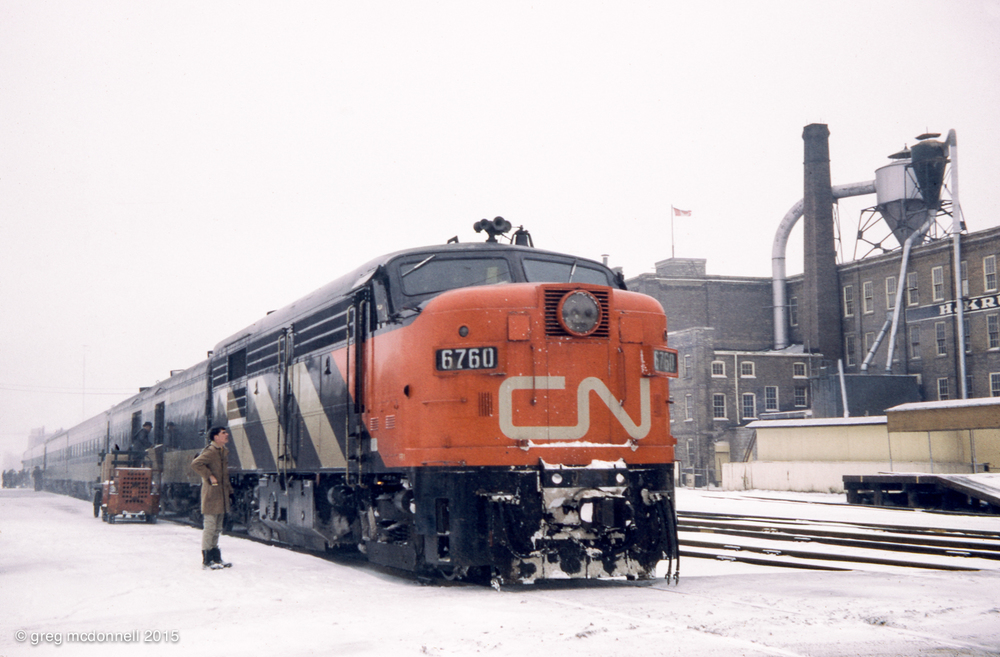 CN train No. 154 calls at Kitchener, Ont., on a snowy afternoon in November 1970.