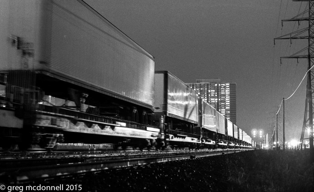 No. 928: unmistakably CP piggyback flats and Montreal-bound trailers at Kipling, December 12, 1983.