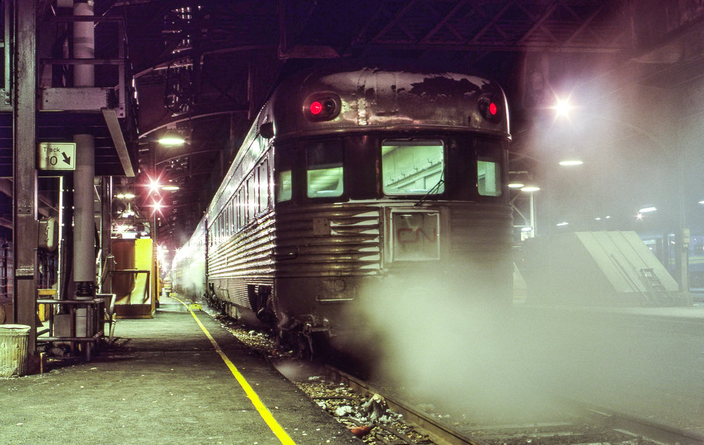 Now boarding on Track 10. CN 302, a battered Budd observation car built in 1937 for the Reading Crusader, carries the markers of VIA No. 79, waiting to depart Toronto Union for Windsor on December 17, 1979.