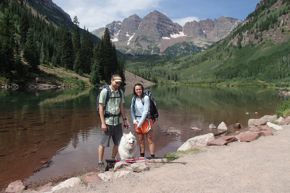 Store owners Lee and Ale Warden with their dog, Aspen, in the Maroon Bells, near Aspen, CO.