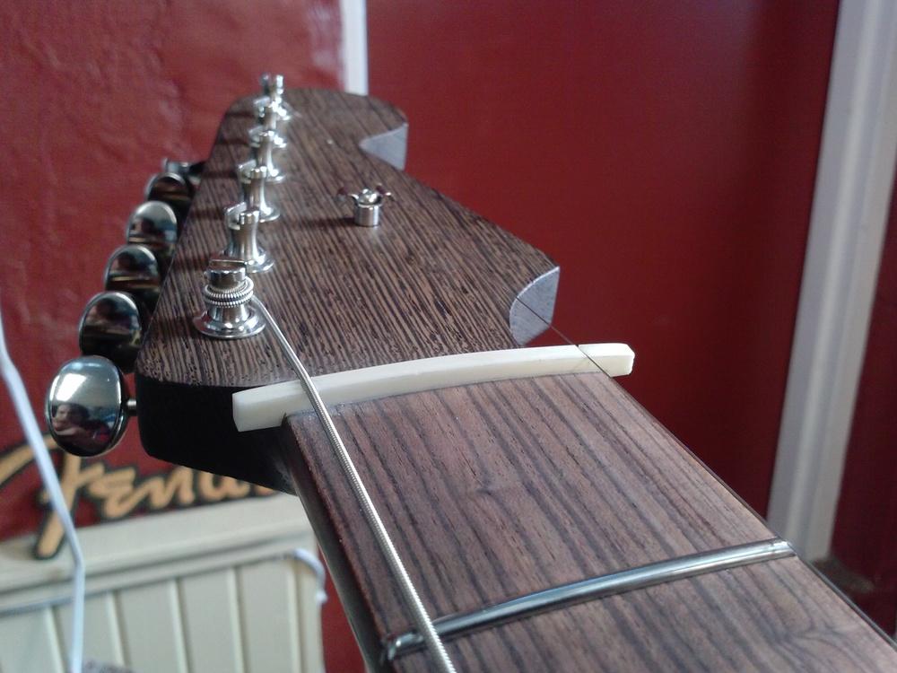 Filing slots for the outside strings