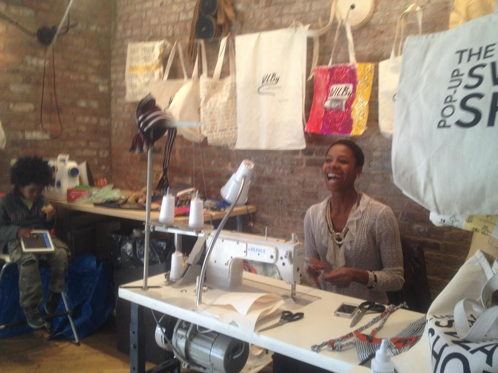Nasozi making aprons in the pop-up sweatshop.