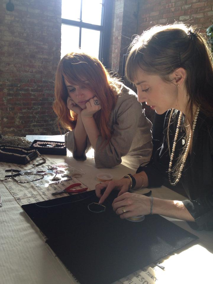 Izaskun teaching Heidi Heyoka how to make a bracelet.