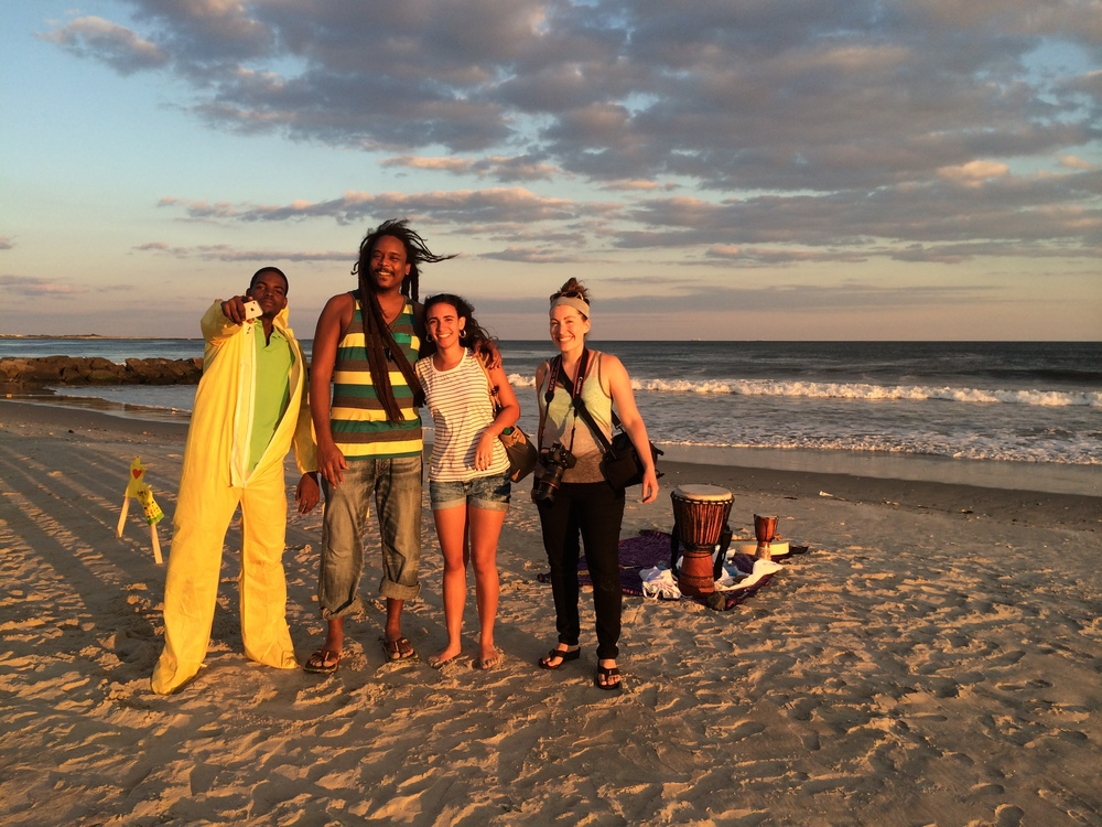 """From photoshoot for the """"tools of life"""" designed to support West Africans in a more sensitive way. Strangers walking along the beach join Hanna (photographer on the far right) and I to bring this pictures to life"""