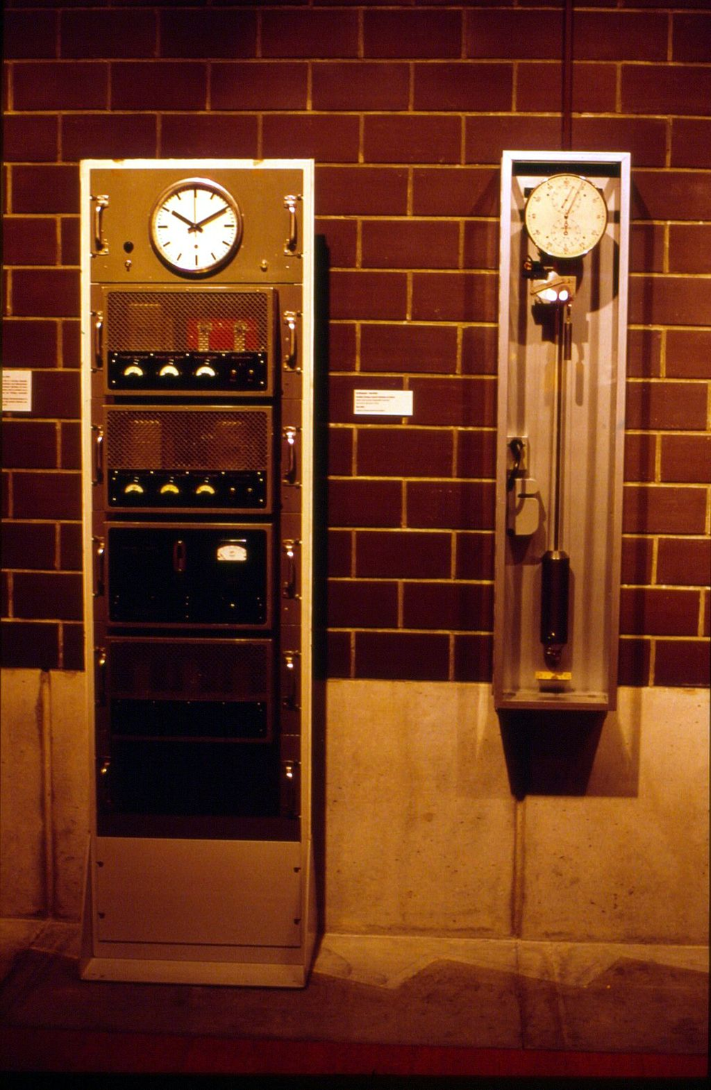 The first Swiss quartz clock, which was made after WW II (left), on display at the International Museum of Horology in La Chaux-de-Fonds.