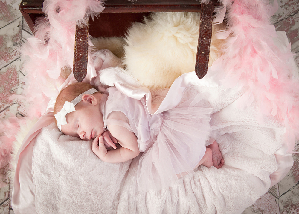 This little angel was the easiest baby we have ever photographed,  she was calm and comfortable in every position we put her in.   Didn't fuss at all.  What a lucky momma!
