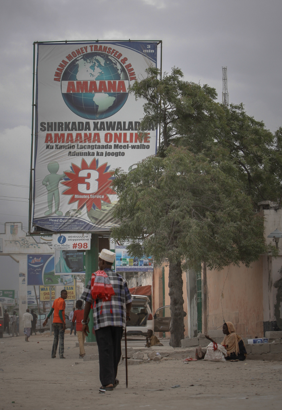 Billboards displaying advertisements for international money transfer companies. AU/UN IST PHOTO / STUART PRICE.