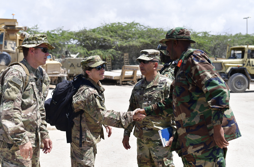 A United States military official shakes hands with the Commander of the AMISOM Ugandan Contingent Brig. General Kayanja Muhanga. This followed the donation of combat vehicles on 25th/Sep/2017, in Mogadishu, Somalia. AMISOM Photo/Allan Atulinda