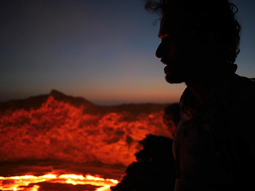 Vijay Shah peering down metres from the edge