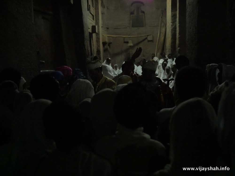 Worshipers gather to be blessed with the Lalibela Cross.