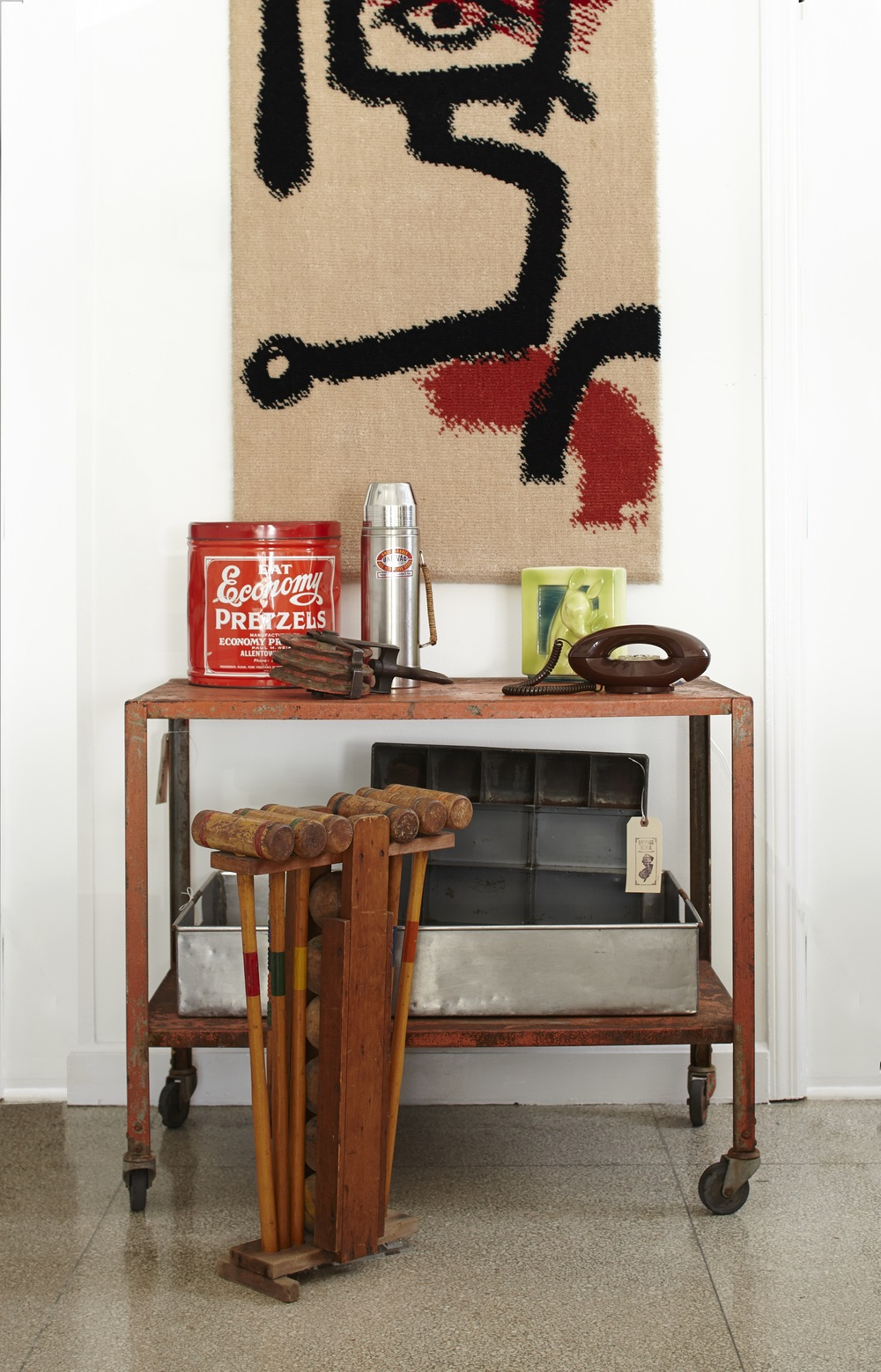 A Salvage Style Vignette Featuring Industrial Salvage, Utilitarian Objects,  And Midcentury Art.