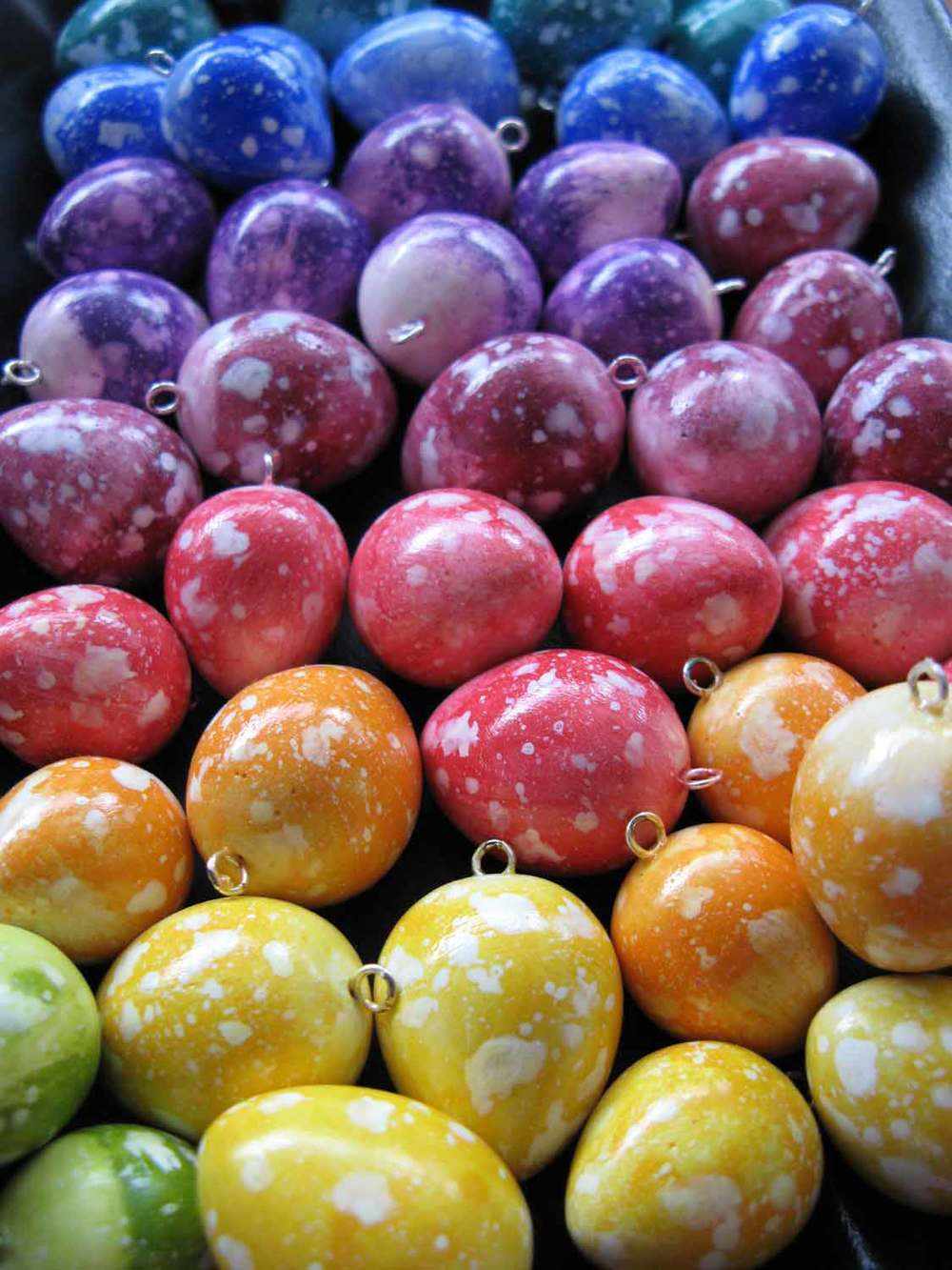 Rainbow speckled plaster eggs.