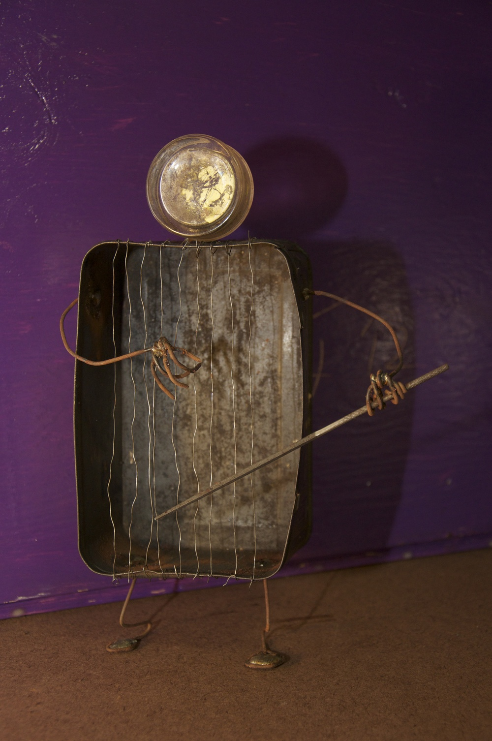 """""""The Musician""""    Part of the series; """"God's Golden Garbage.""""    Tobacco tin, steel wire, file, inkwell. Inspired by a Tom Waits story. 2012"""