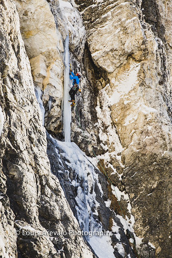 Nathan Smith on the ice pillar during the first ascent of The Bone Collector. Photo ©Louis Arevalo