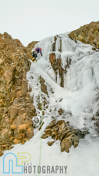 Nikki climbing the first and crux step of ice. Photo © Matt Scullion